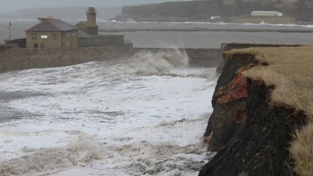 whitehaven harbour and sea cliffs during the january 2014 period of storm surge high tides and storm force winds the coastline took a battering... - atlantic ocean stock videos & royalty-free footage