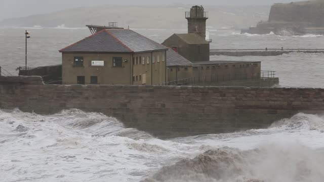 whitehaven harbour and sea cliffs during the january 2014 period of storm surge high tides and storm force winds the coastline took a battering... - weathered stock videos & royalty-free footage