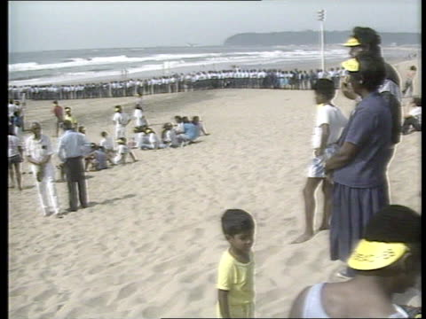 'whites only' beach protest:; south africa: durban: 'golden mile': ext tgv 'whites only' beach tlbv large group riot police along beach blacks... - waten stock-videos und b-roll-filmmaterial