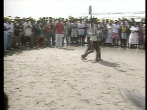 vídeos de stock, filmes e b-roll de 'whites only' beach protest south africa durban 'golden mile' ext tgv 'whites only' beach large group riot police along beach ms blacks walking... - desmond tutu