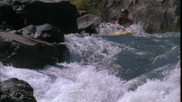 Whitewater kayaker descends rapids and capsizes, South Africa Available in HD.