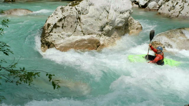 hd: whitewater kayaker paddling against river current - rapid stock videos & royalty-free footage