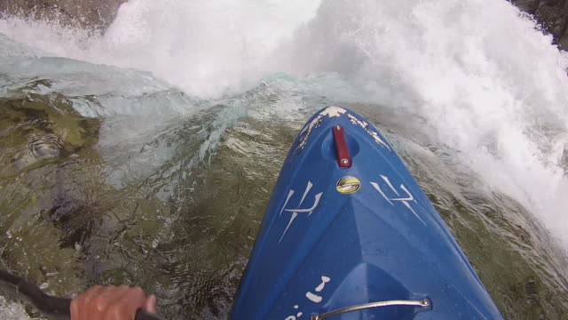 whitewater kayaker plunges over waterfall - oar stock videos & royalty-free footage