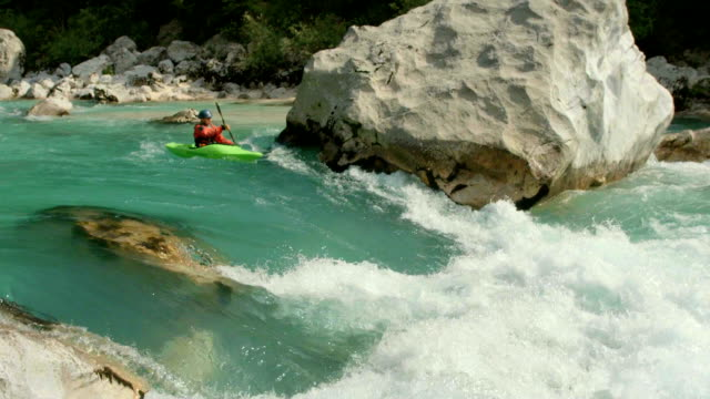 hd: whitewater kayaker running the rapid - young men stock videos & royalty-free footage