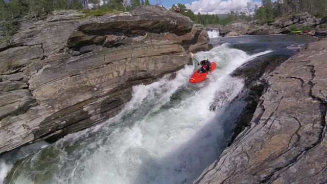 whitewater kayer descends turbulent rapids - rapid stock videos & royalty-free footage