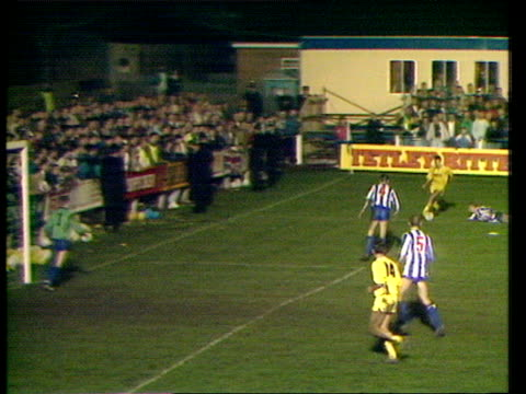 stockvideo's en b-roll-footage met whitley bay defender slips over giving warren joyce space to cross for mike flynn who misses absolute sitter from one yard whitley bay vs preston... - whitley bay