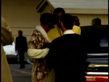 whitney houston and bobby brown arrive surrounded by security. - whitney houston stock-videos und b-roll-filmmaterial