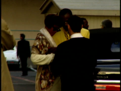 Whitney Houston and Bobby Brown arrive surrounded by security