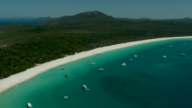 whitsundays aerial whitehaven beach luxury yachts barrier reef - anchored stock videos & royalty-free footage