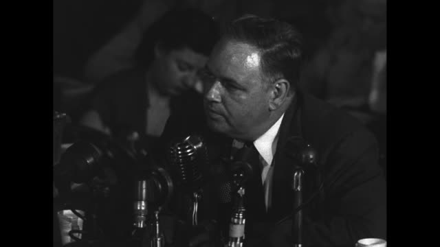 whittaker chambers former communist sits behind microphones and testifies before the house unamerican activities committee about accused communist... - house committee on unamerican activities stock videos & royalty-free footage