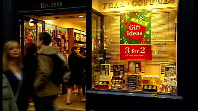 oxford street shoppers england london oxford street ext general views of whittard of chelsea shop and sign christmas poster in window - christmas poster stock videos & royalty-free footage