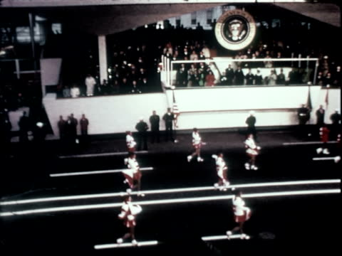 whittier high school marching band performing for richard nixon class of 1930 inaugural parade / us president richard nixon standing smiling waving... - parade float stock videos and b-roll footage