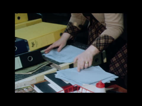 ; b) 1.10 england: dudley: int police operations room: booth at desk with papers: detectives working at desks: bv booth and another at map zoom in... - telephone stock videos & royalty-free footage