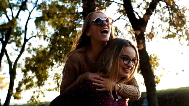 who doesnt love a good piggyback - female friendship stock videos & royalty-free footage