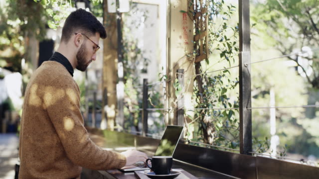 who needs an office when you've got cafes like these? - coffee shop stock videos & royalty-free footage