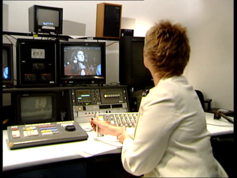 itv documentary itn england london ros taylor sitting in edit suite watching recording of show - millionär stock-videos und b-roll-filmmaterial