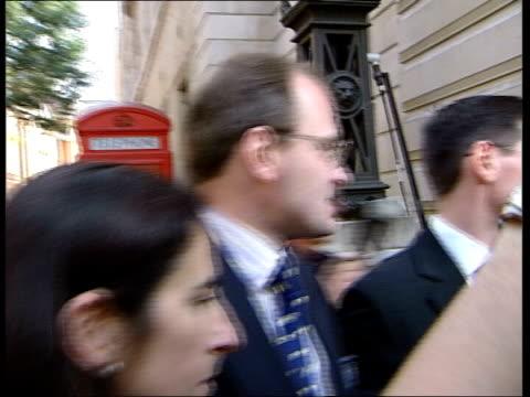 Major Ingram in court ITN ENGLAND London Bow Street Magistrates Court Major Charles Ingram wife Diana Ingram towards to court thru press scrum TRACK...