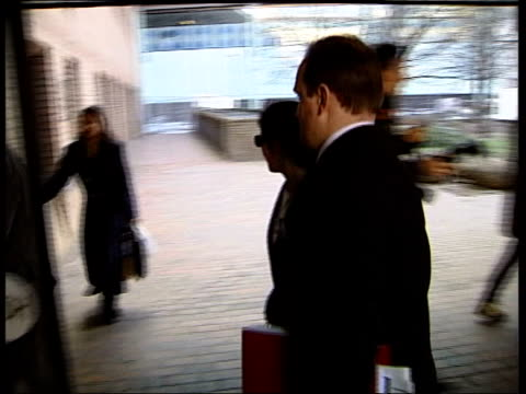 'who wants to be a millionaire' fraud trial: day 2; mls southwark crown court building, tilt down to press outside charles ingram posing to press,... - gioco televisivo video stock e b–roll