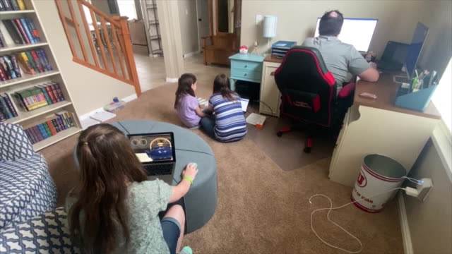 whole family in one room: father working, mom helping daughters to study. jennifer haubrich , helps teach her daughter's sydney and cali at their... - utah stock videos & royalty-free footage
