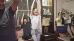 Whole family on dancing game together in covid-19 virus lockdown situation