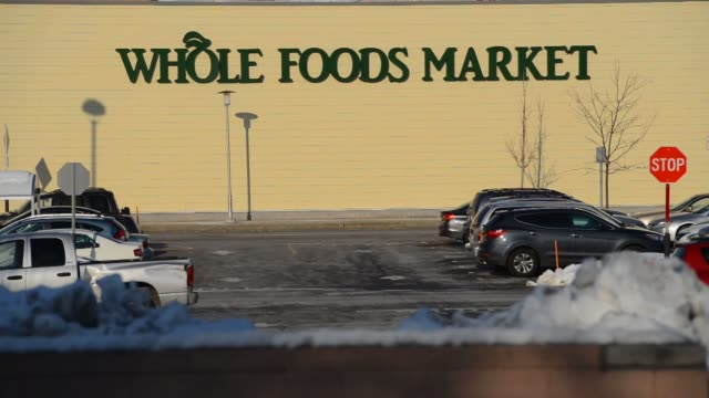 whole foods location at the outlets at bergen town center in paramus new jersey us on monday february 10 wide shot of whole foods market signage and... - whole foods market stock videos and b-roll footage