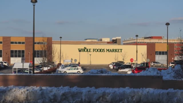 whole foods location at the outlets at bergen town center in paramus new jersey us on monday february 10 wide shot of car passing on a highway and... - whole foods market stock videos and b-roll footage