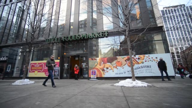whole foods location in tribeca new york ny us on monday february 10 wide shot of pedestrians passing by the whole foods store front wide shot tilt... - whole foods market stock videos and b-roll footage