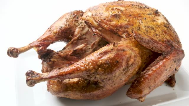 whole organic roasted turkey on white background - roast turkey stock videos & royalty-free footage