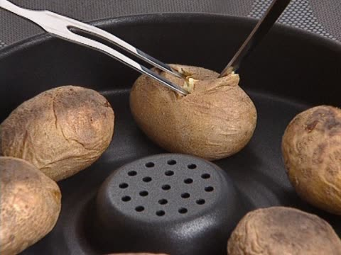 Whole potatoes backed in pan