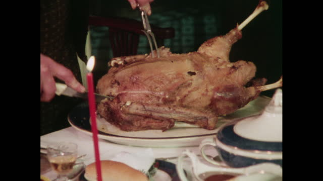 a whole roast goose being carved at christmas, 1970s - slice stock videos & royalty-free footage