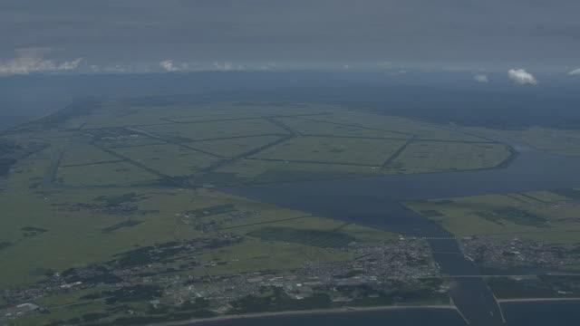 aerial, whole village of ogata, akita, japan - polder stock videos and b-roll footage