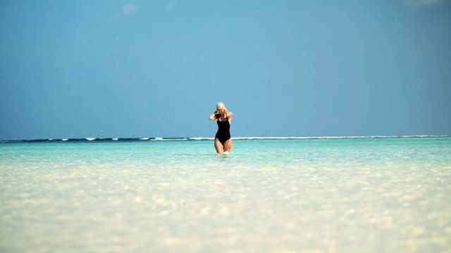 whole wet seductive blonde woman walking through ocean, maldives - dune buggy stock videos and b-roll footage
