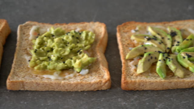 wholewheat bread toast with avocado - whole stock videos and b-roll footage