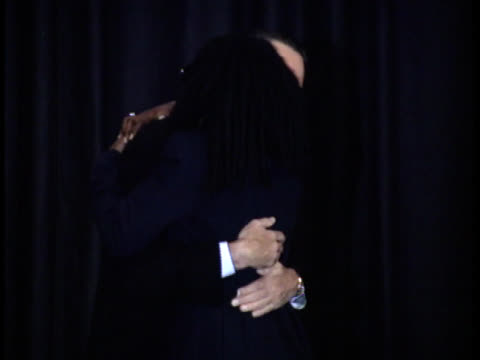 whoopi goldberg and robert de niro hug ted danson by their side - friars roast 1993 stock videos and b-roll footage