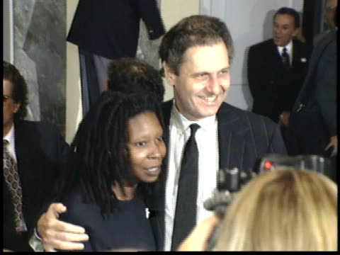 whoopi goldberg and unidentified man posing for paparazzi on red carpet - whoopi goldberg stock videos & royalty-free footage