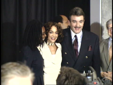 whoopi goldberg jasmine guy and unidentified man posing for paparazzi on red carpet - friars roast 1993 stock videos and b-roll footage