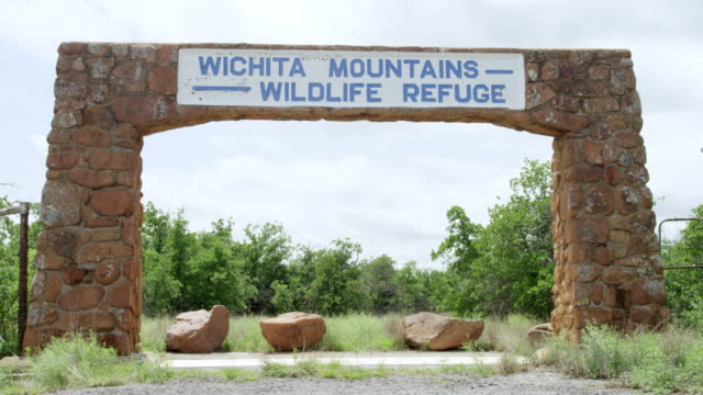 ms wichita mountains wildlife refuge entrance sign on stone gate / wichita mountains wildlife refuge, oklahoma, united states  - entrance sign stock videos & royalty-free footage