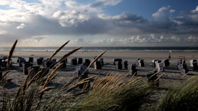 wicker beach chairs and beachgrass - norderney - north frisian islands stock videos & royalty-free footage