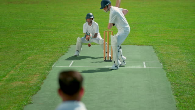 slo mo tu wicket keeper catching the ball missed by the batsman - batsman stock videos & royalty-free footage