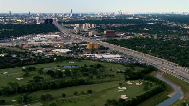 wide aerial approach across freeway toward downtown houston. shot in 2007. - artbeats stock videos & royalty-free footage