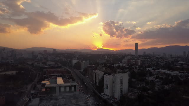 Wide aerial, Mexico City skyline during sunset
