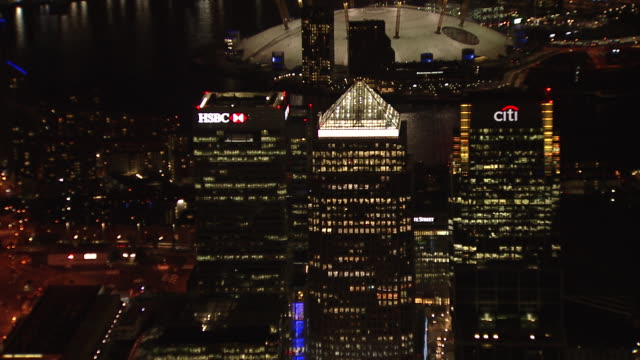 wide aerial of canary wharf with the o2 in background. - the o2 england stock videos & royalty-free footage