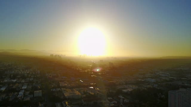 wide aerial of sun in los angeles basin - smog stock videos & royalty-free footage