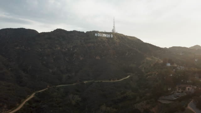 wide aerial of the hollywood sign - academy of motion picture arts and sciences stock videos & royalty-free footage