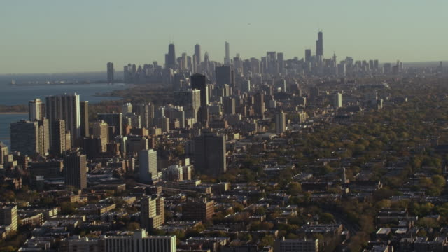 Wide aerial shot of Chicago skyline middle of day