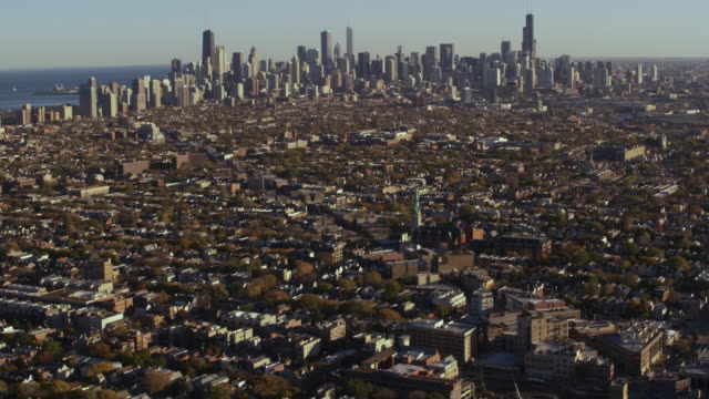 wide aerial shot of chicago skyline middle of day - willis tower stock videos and b-roll footage