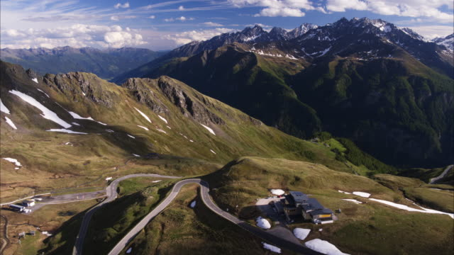 wide aerial shot of house on mountain pass / grossglockner, carinthia, austria - carinthia stock videos & royalty-free footage