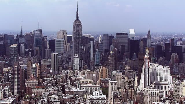 wide aerial shot of midtown manhattan, new york city. helicopter flies over midtown looking at empire state building and metlife among others. - 2010 stock videos & royalty-free footage