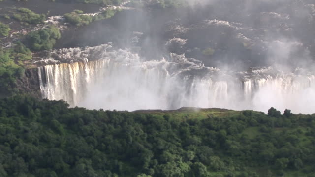wide aerial shot of the victoria falls - victoria falls stock videos and b-roll footage