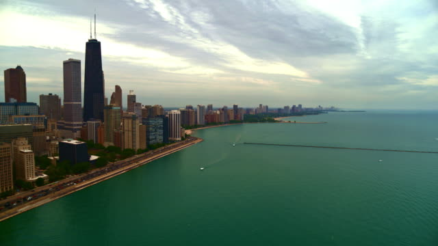 wide aerial shot over lake michigan and chicago skyline - willis tower stock videos & royalty-free footage